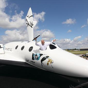Sir Richard Branson with his SpaceShipTwo