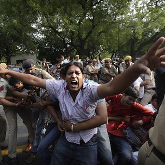 Indians protest against the rape of a five-year-old girl in New Delhi (AP)