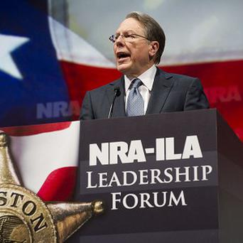 NRA vice president Wayne LaPierre urged members to never surrender their weapons (AP Photo)