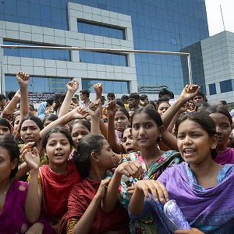 Workers protest to demand better conditions following the fatal factory collapse in Dhaka (AP)