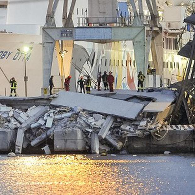 Rescuers search what is left of the control tower of the port of Genoa, northern Italy (AP/Francesco Pecoraro)