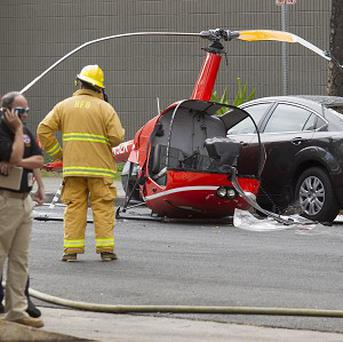 The wreckage of a small helicopter that crashed in Honolulu (AP/Eugene Tanner)