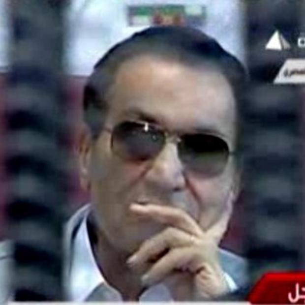 Former Egyptian president Hosni Mubarak inside the defendant's cage in a courtroom in Cairo (AP/Egyptian State Television via AP video)