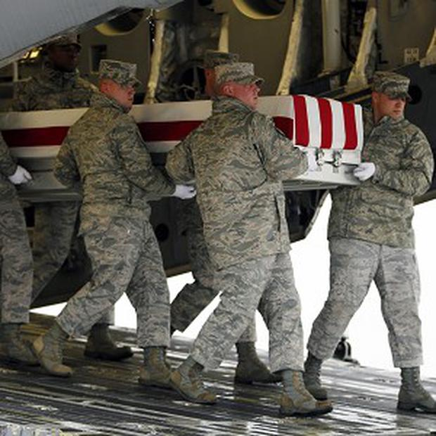 The US victim of an earlier attack is repatriated (AP)