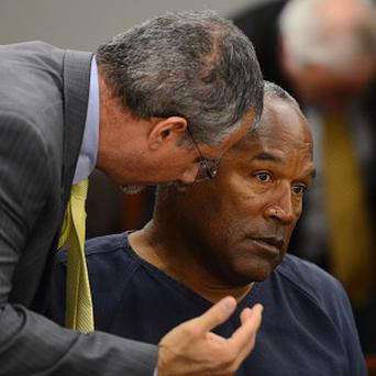 Simpson consults with one of his lawyers in court (AP)