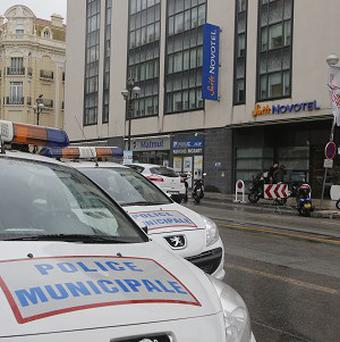 Police cars outside a hotel in Cannes after jewellery worth nearly one million dollars was stolen (AP)