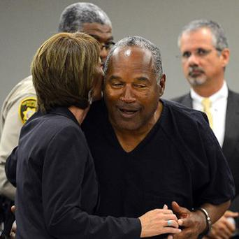 OJ Simpson embraces his lawyer Patricia Palm at the end of a court hearing in Las Vegas (AP)