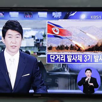 A South Korean TV news programme reports an alleged missile launch conducted by North Korea (AP)