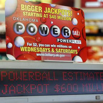 A sign at a shop advertises the Powerball Lottery in Oklahoma City (AP)