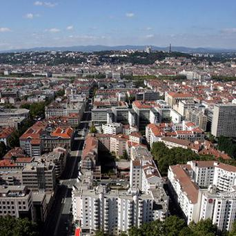 A British man is said to have admitting slitting his two children's throats in a suburb of Lyon