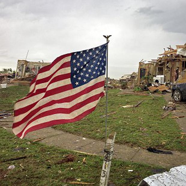 An American flag flaps in the wind near Plaza Towers Elementary School in Moore, Oklahoma (AP/The Dallas Morning News, Brad Loper)