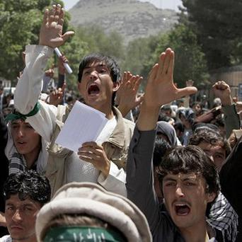 Male students protest in front of Kabul University against the decree on Elimination of Violence Against Women (AP/Ahmad Jamshid)