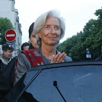 Christine Lagarde leaves a special court house in Paris (AP)