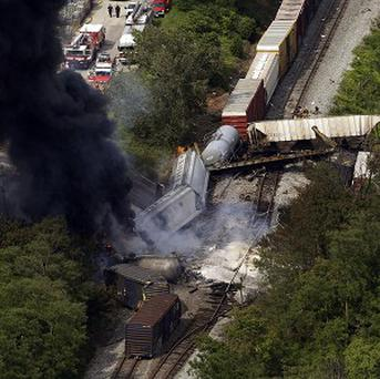 A freight train derailment led to an explosion that rattled homes at least a half a mile away (AP)