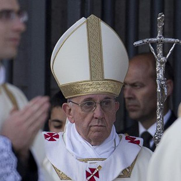 Pope Francis arrives to celebrate the Corpus Domini mass (AP)