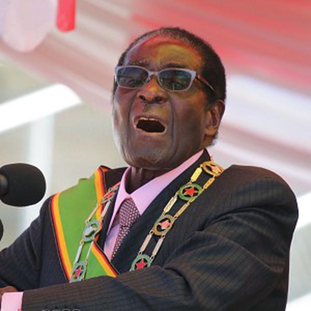 Zimbabwe's president Robert Mugabe has been ordered to set a date for elections (AP)