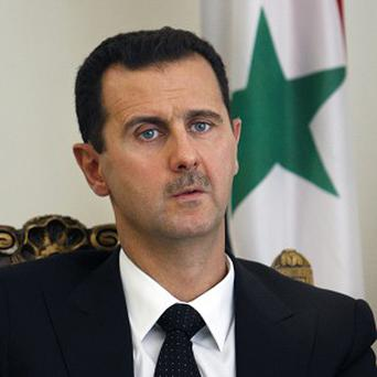 Syrian president Bashar Assad claims his regime has received a first shipment of missiles from Russia (AP)