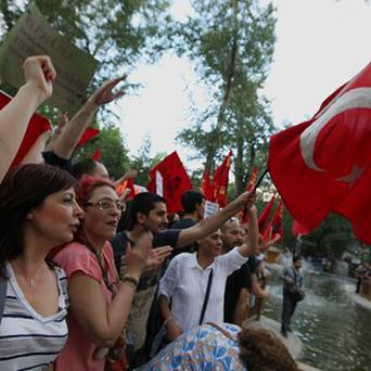 Thousands of people gather in support of demonstrators staging a sit-in to prevent the uprooting of trees at an Istanbul park, in Ankara, Turkey (AP)