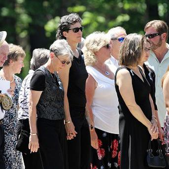 Family and friends arrive for a memorial service for Nancy Lanza, whose son killed her and children and teachers at Sandy Hook Elementary (AP)