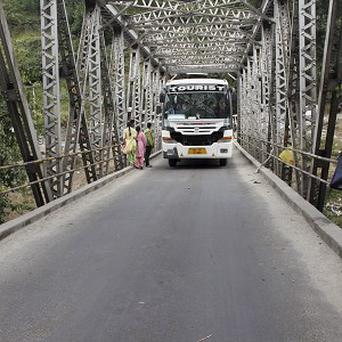 Indian policemen check vehicles after an American woman was gang-raped in the northern resort town of Manali (AP)