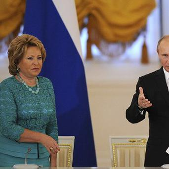 Vladimir Putin with the speaker of Russia's senate Valentina Matvienko, who has claimed the Boston bombings could have been prevented (AP)