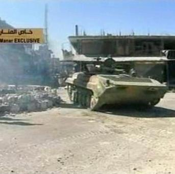 Video broadcast on Lebanon's Hezbollah-owned TV station Al-Manar shows a Syrian army tank in Qusair (AP/Al-Manar Television)