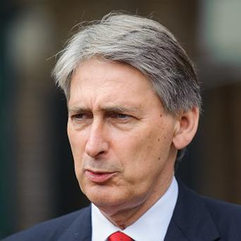 Philip Hammond suspended transfers in November amid claims that detainees were being abused while in Afghan custody