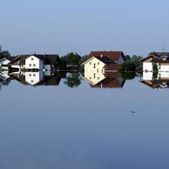 Buildings are reflected in the floodwater of the river Danube in Deggendorf, southern Germany (AP)