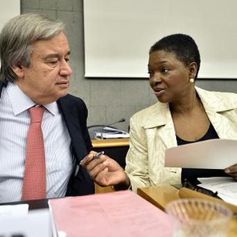 UN relief official Valerie Amos speaks with Antonio Guterres, UN High Commissioner for Refugees, before the launch of the Syrian aid appeal in Geneva (AP)