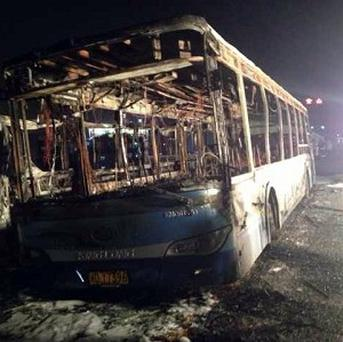 The wreckage of an express bus that burst into flames in Xiamen, China, killing more than 40 people (AP/Xinhua)