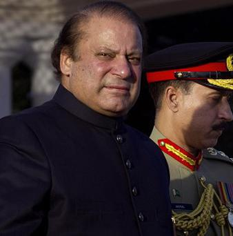 Pakistan 's prime minister Nawaz Sharif has called on the United States to end drone attacks (AP)