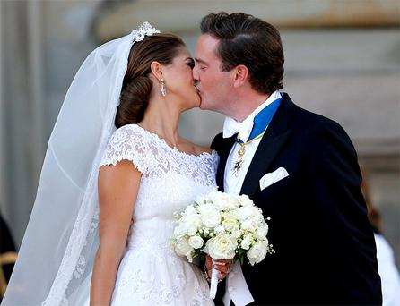 Sweden's Princess Madeleine kisses U.S.-British banker Christopher O'Neill outside the royal church after their wedding ceremony in the royal castle in Stockholm
