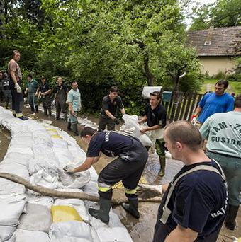 Soldiers and volunteers build a dam with sandbags transported by helicopter against floodwater on the River Danube in Hungary (AP)