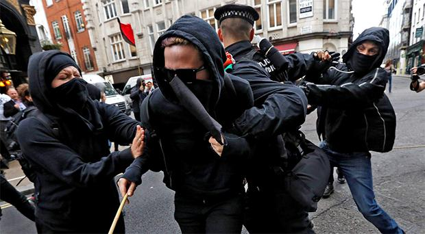 Protesters, demonstrating against the upcoming G8 summit, scuffle with police in central London