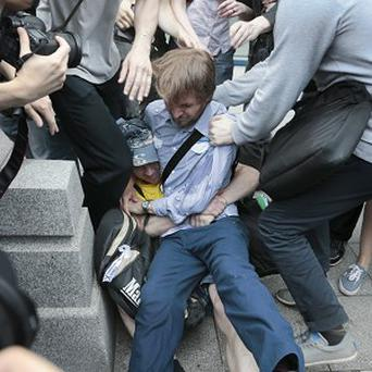 Gay rights activists clash with opponents in Russia