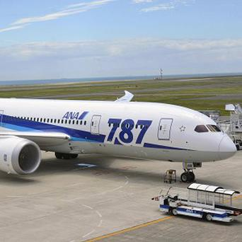 An All Nippon Airways Boeing 787 is stranded on the tarmac since an engine would not start at Yamaguchi-Ube Airport in Ube, western Japan (AP)