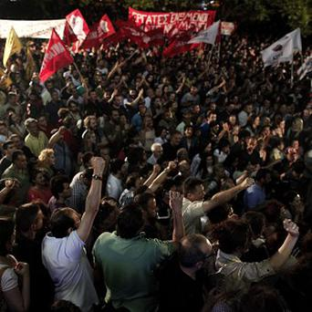 Thousands of people protested over a decision by the government to close down Greece's state broadcaster (AP)