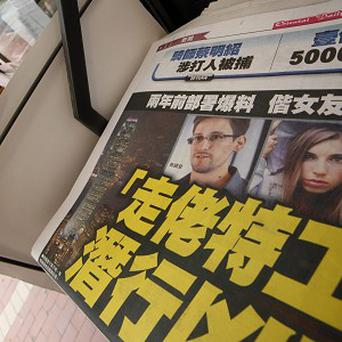 Edward Snowden is front page news in Hong Kong where he is living (AP)