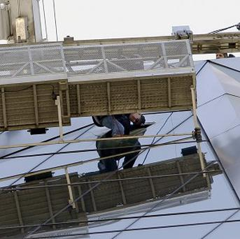 Window cleaners have been rescued from the Hearst Building in New York City (AP)