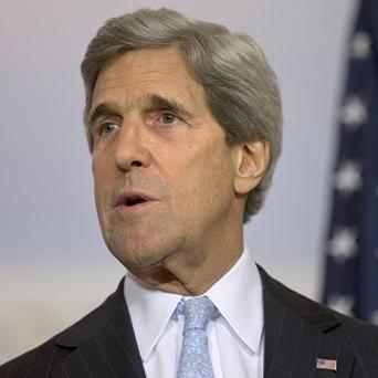 US Secretary of State John Kerry has held talks on Syria with William Hague (AP)