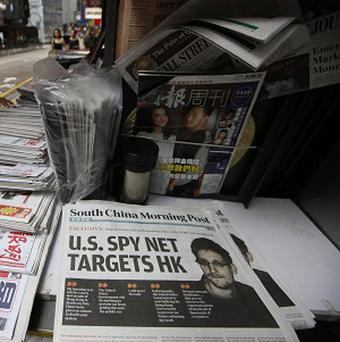 A picture of Edward Snowden is displayed on the front page of South China Morning Post at a news stand in Hong Kong (AP)