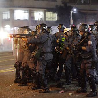 Police fire rubber bullets at demonstrators in Sao Paulo, Brazil (AP)