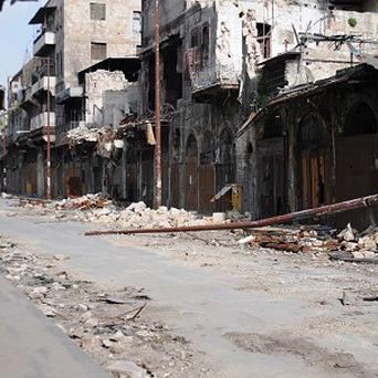 Wrecked buildings in a street after fighting between government troops and rebels in Aleppo (AP/Aleppo Media Centre)
