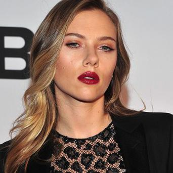 Scarlett Johansson is suing over a novel that uses her name and image and explores the challenges of being beautiful (AP)