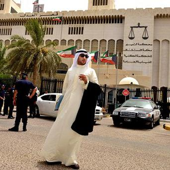 A lawyer stands outside the constitutional court in Kuwait City after lawmakers forced new parliamentary elections (AP)