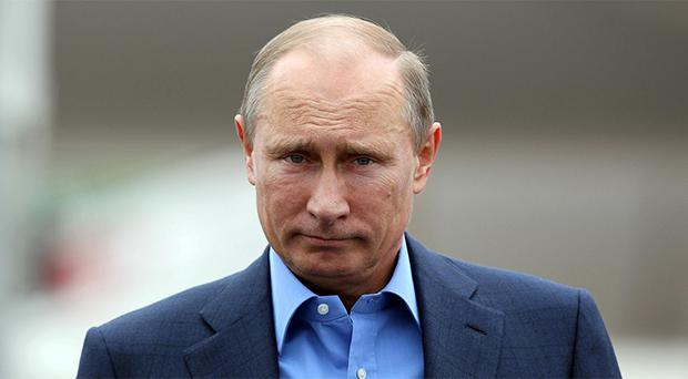 Russia's President Vladimir Putin arrives to attend the Enniskillen G8 summit