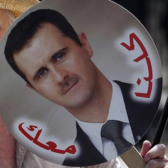 Just 17 per cent in a poll agreed they would support the British Government if it supplied weapons to forces opposed to Bashar Assad (AP)