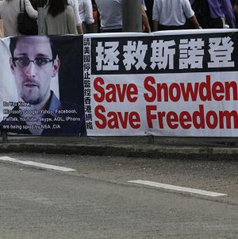 A banner supporting Edward Snowden, a former CIA employee who leaked top-secret documents, in Hong Kong (AP)