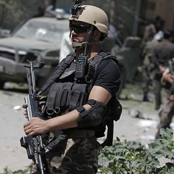 Afghan security forces guard at the site of a suspected Taliban blast in Kabul (AP)