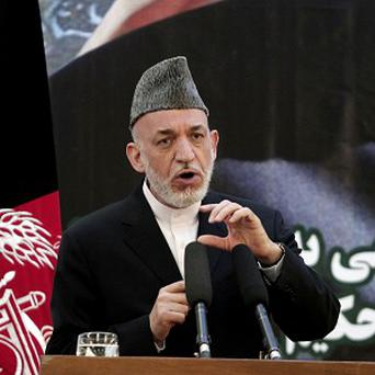 Afghan president Hamid Karzai has suspended handover talks with the US (AP)